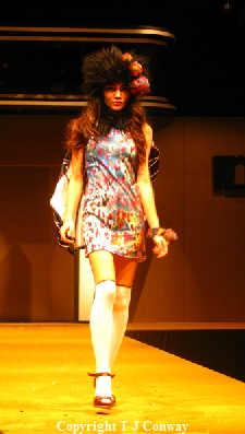 photograph of fashion model in white socks mini dress hat and accessories.