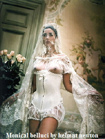 monica belluci, in lace basque , bridal image ,  photograph by helmut newton
